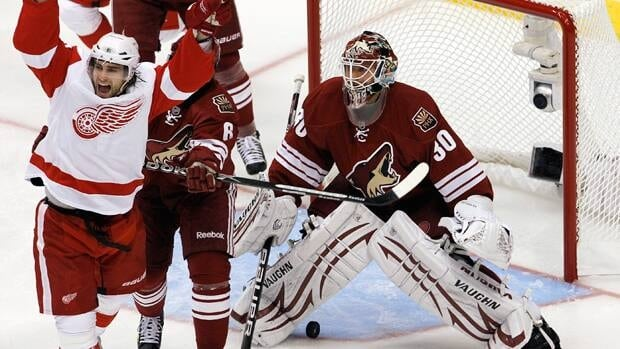 Detroit Red Wings' Patrick Eaves, left, celebrates a goal scored by teammate Ruslan Salei as Phoenix Coyotes' Ilya Bryzgalov (30) looks on during the first period in Game 3 Monday in Glendale, Ariz.