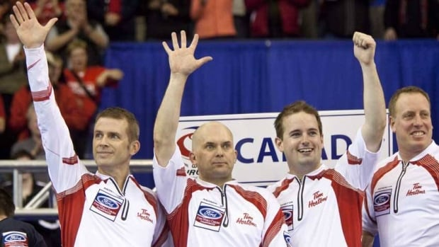 The Canadian team of, left to right, Jeff Stoughton, Jon Mead, Reid Carruthers and Steve Gould waves to the crowd in Regina after winning the gold medal.