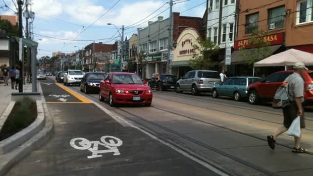 The newly resurfaced streetscape at Roncesvalles Avenue includes new cycling lanes. Residents have waited for the construction to end for two years.