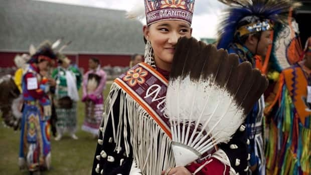 Manito Abhee Sage Speidel, 14, from the Lakota nation, wears traditional clothing at an event celebrating National Aboriginal Day in Winnipeg in June 2011. The latest numbers of Statistics Canada show that the aboriginal population is expected to grow at an annual rate of 1.1 and 2.2 per cent, faster than the non-aboriginal population growth rate of one per cent.