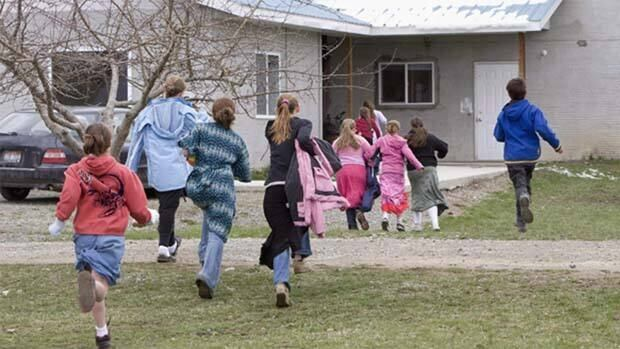 Children run back to class following a recess at Mormon Hills school in the polygamous community of Bountiful, B.C.