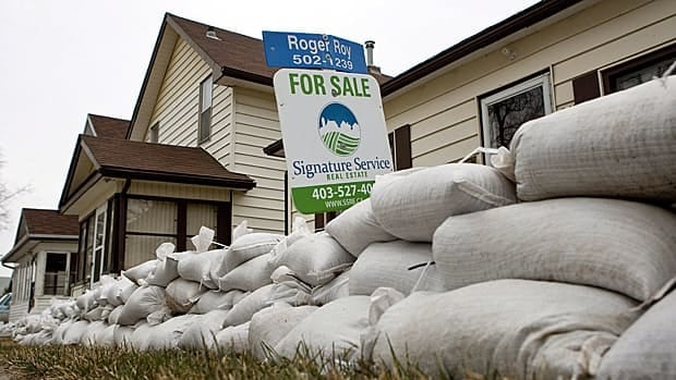 Homeowners in Manitoba, Saskatchewan and Alberta are braced for flooding. Liberal Leader Michael Ignatieff says the federal government needs a strategy to defend against future floods. (Jeff McIntosh/Canadian Press)