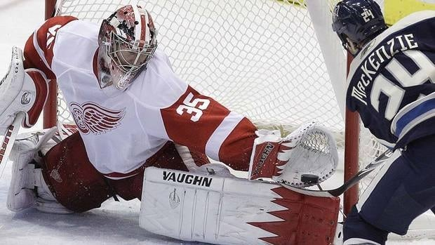 Red Wings goalie Jimmy Howard has given up only five goals in three games this season and is 7-1-1 with a 1.61 goals-against average in 10 career starts versus Derek MacKenzie, left, and the Blue Jackets.