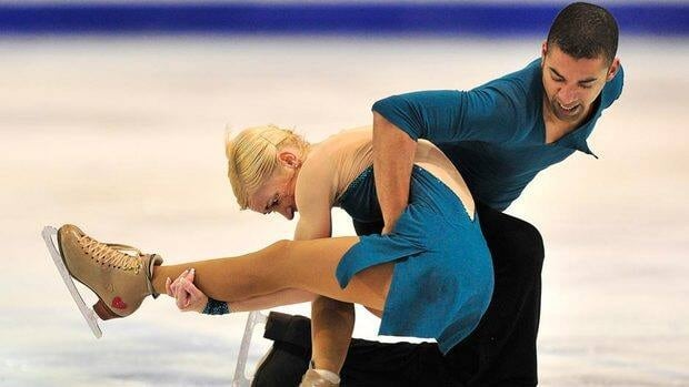 Aliona Savchenko and Robin Szolkowy of Germany perform their free program to win the gold medal in the pairs competition at the ISU Grand Prix of Figure Skating Final Saturday.
