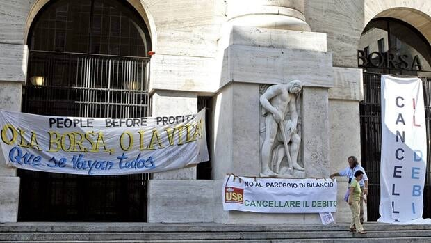 Anti-austerity banners hang outside the stock exchange in Milan in September.