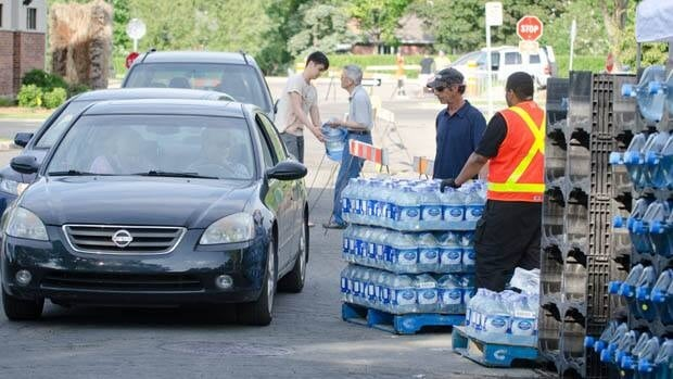 Residents stocked up on water for three days at a community centre in Dorval, Que. during a water ban. The city is seeking repayment from Air Canada and a contractor working at the airline's Trudeau Airport hangar after the contractor allegedly connected a reservoir full of stagnant water to the city's drinking water by accident.