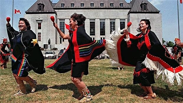 A group from Gitxsan First Nation in British Columbia dances in front of the Supreme Court of Canada in 1997.
