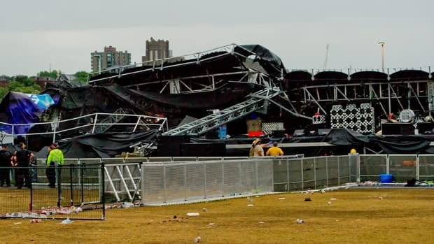 The concert grounds at the Ottawa Bluesfest emptied after a powerful storm blasted the area and collapsed the main stage.
