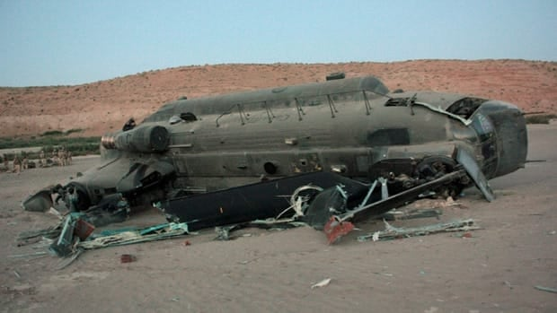 A Canadian helicopter sits on its side after it crashed on landing in the Panjwaii district of Afghanistan on Monday. Four Canadian soldiers were injured, one of them seriously, in the incident.