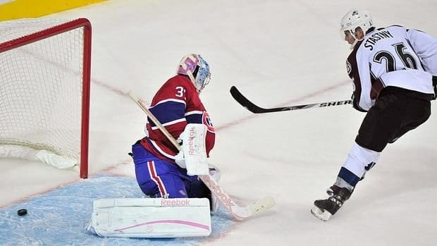 Colorado Avalanche's Paul Stastny scores on a break-away past Montreal Canadiens goalie Carey Price during the second period.