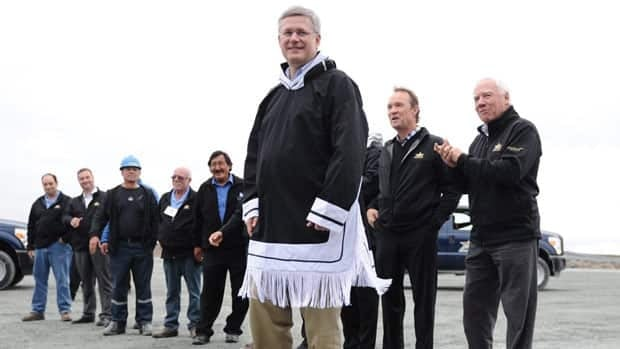 Prime Minister Stephen Harper, at a mine in Nunavut this summer, defended the North's economic development agency on Friday.