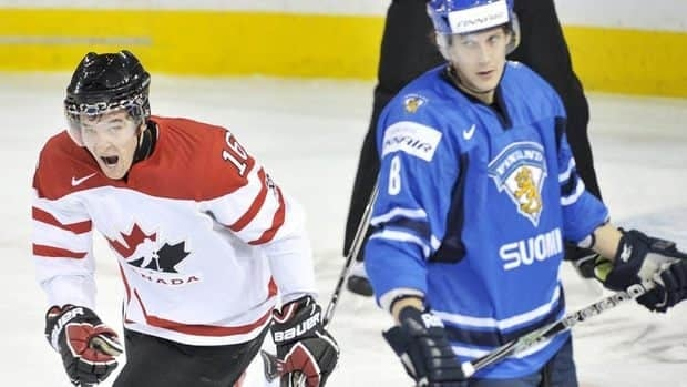 Team Canada forward Mark Stone, left, celebrates one of his three goals Monday in front of Finland defenceman Miro Aaltonen, right. Team Canada got some bad news after the 8-1 win, learning that forward Denate Smith-Pelly will miss the remainder of the tourney with a fractured left foot.