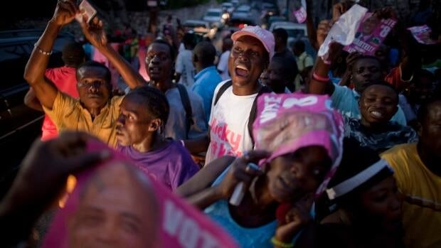 "Supporters of Michel ""Sweet Micky"" Martelly celebrate in Port-au-Prince on Monday after Haiti's electoral council announced preliminary results for the election runoff showed the singer had been elected president. Associated Press/Ramon Espinosa"