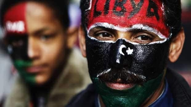 People with their faces painted take part in a rally supporting coalition airstrikes in Libya in the rebel-held city of Benghazi on Wednesday.
