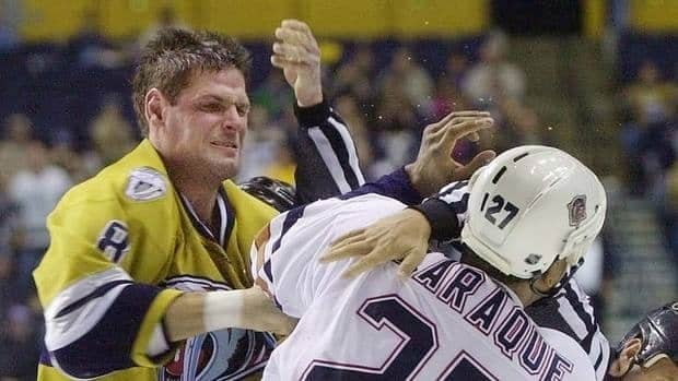 "Stu Grimson, left, seen here in December 2001, was one of the targets of HNIC personality Don Cherry, who called the former Predators tough guy and fellow ex-NHL tough guys Chris Nilan and Jim Thomson ""pukes"" for speaking out against fighting in the sport."
