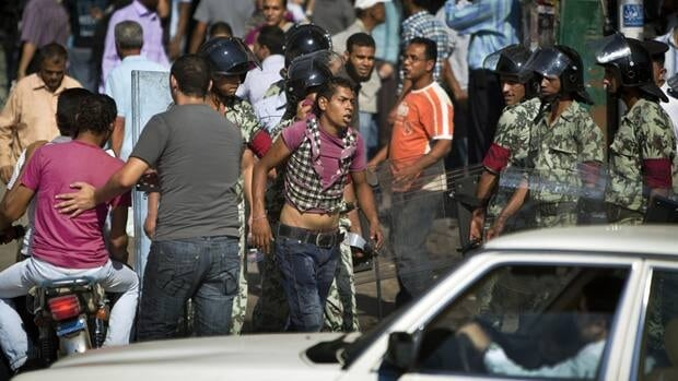 Egyptian soldiers arrest a man after tearing down a protest camp in Tahrir Square in downtown Cairo on Monday. Troops clashed with a small group of the protesters, who want more political changes and the country's ex-president, Hosni Mubarak, to face justice.