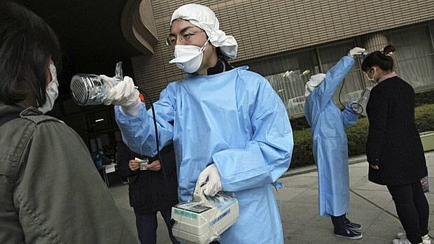 Women are screened for radiation exposure at an evacuation centre in Fukushima. Radiation levels have spiked around the hobbled nuclear plant in the region.