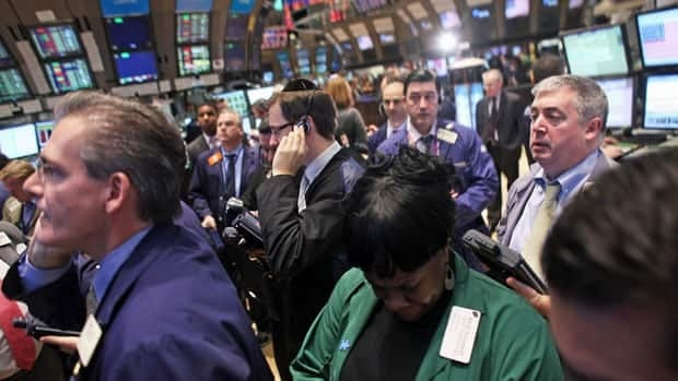 Markets, including the New York Stock Exchange, gave back some of their gains Monday on reports of a coming credit warning on European economices.