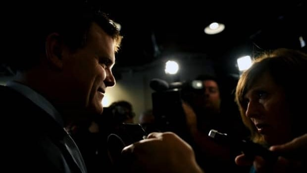 Foreign Affairs Minister John Baird speaks to reporters in Ottawa on August 18.