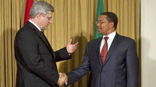 Prime Minister Stephen Harper, left, meets with Tanzanian President Jakaya Kikwete at his hotel before making a speech on maternal health at the United Nations Tuesday, September 20, 2011.