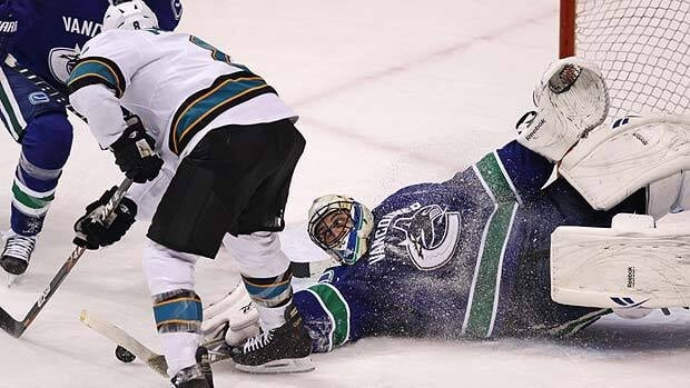 Vancouver Canucks goalie Roberto Luongo stops San Jose forward Joe Pavelski during a Jan. 20 game at Rogers Arena.