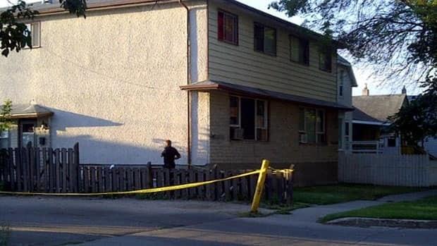 Police investigate the scene of gunshots on Ingersoll Street near Notre Dame Avenue.