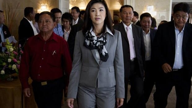 Yingluck Shinawatra arrives at a news conference on the formation of her coalition government in Bangkok on July 4, a day after her stunning election victory. She will be Thailand's first female prime minister.