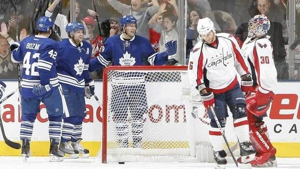 Maple Leafs forwards Tyler Bozak, left, Phil Kessel, centre, and Joffrey Lupul celebrate Lupul's goal against the Washington Capitals on Saturday night.