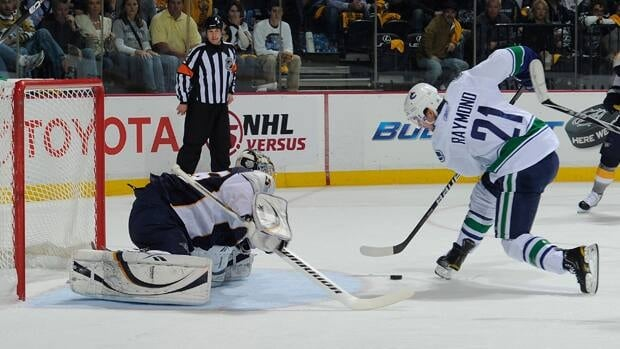 Mason Raymond (21) of the Vancouver Canucks scores a goal against Pekka Rinne (35) of the Nashville Predators in Game 6 on Monday in Nashville.