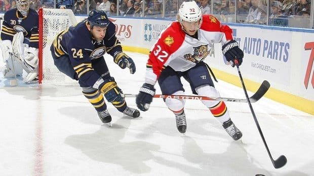 Buffalo's Robyn Regehr, left, defends against Florida's Kris Versteeg on Saturday.