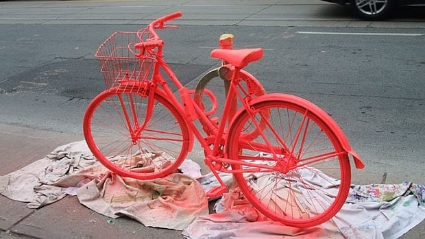 The bike was painted a bright orange to brighten up an otherwise drab section of Dundas Street West.