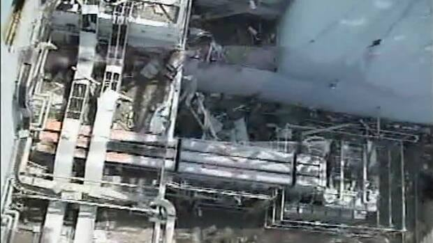 The north side of the damaged reactor building of Unit 1 at the Fukushima Daiichi nuclear power plant is shown in this April 21 image from video footage taken by T-Hawk drone aircraft.