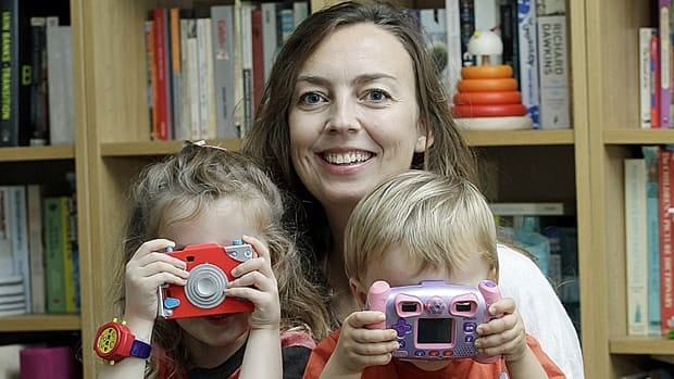 Women shouldn't think a C-section is going to be a walk in the park, says Pauline Hull, who runs a website about elective cesarean child birth. She is posing with her children.