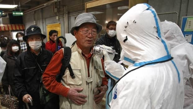 An evacuee is screened for radiation exposure at a testing centre Tuesday in Koriyama city, Fukushima prefecture, Japan, after a nuclear power plant on the coast of the prefecture was damaged by Friday's earthquake.