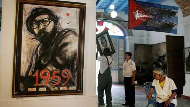 Cuba's leader Fidel Castro is depicted in a painting at the Oficios gallery in Old Havana, Cuba. Castro said Tuesday he quit as Communist Party chief five years ago.