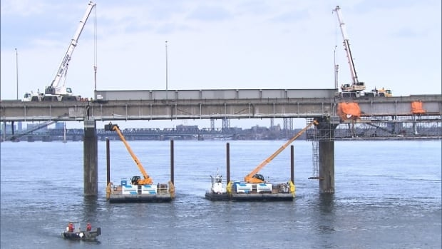 Crews work on Montreal's aging Champlain Bridge.