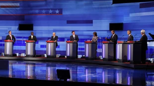 Republican presidential candidates, from left, former Pennsylvania senator Rick Santorum, businessman Herman Cain, Representative Ron Paul from Texas, former Massachusetts governor Mitt Romney, Representative Michele Bachmann from Minnesota, former Minnesota governor Tim Pawlenty, former Utah governor Jon Huntsman, and former House Speaker Newt Gingrich are seen during the Iowa GOP/Fox News debate in Ames, Iowa, Thursday.