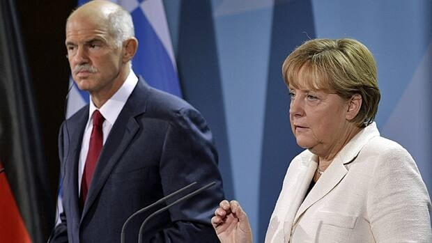 German Chancellor Angela Merkel, right, and the Prime Minister of Greece, Georgios Papandreou, left, adress the media prior to a dinner at the chancellery in Berlin on September 28.