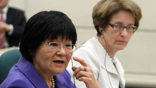 International Co-operation Minister Bev Oda, left, and CIDA President Margaret Biggs appear as witnesses at a Commons committee hearing in Ottawa into whether Oda is in contempt of Parliament, March 18, 2011.
