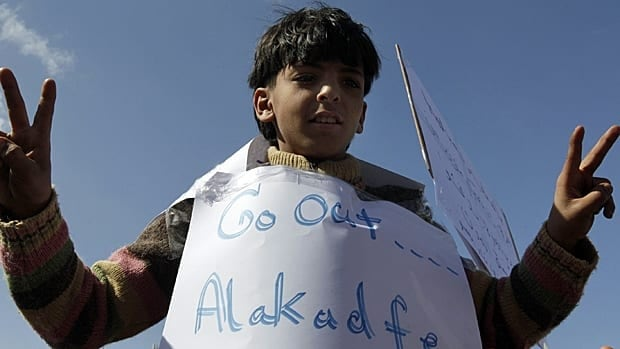A Libyan boy flashes a V sign as he protests against Libyan Leader Moammar Gadhafi, in Tobruk, Libya, on Wednesday.