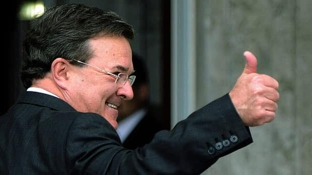 Finance Minister Jim Flaherty gestures to reporters as he enters Rideau Hall for the cabinet swearing-in ceremony on May 18, 2011.