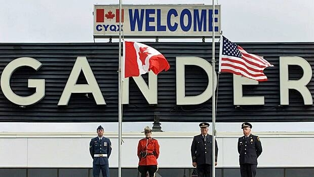 The Canadian and United States flags were lowered to half-mast at a commemorative ceremony in Gander, N.L., on Sept. 11, 2002, to mark the first anniversary of the attacks against the U.S.