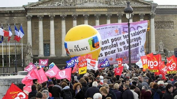 Private and public sector workers take part in a demonstration to denounce austerity measures in front the National Assembly in Paris on Tuesday. Trade unions organized anti-austerity protests across France, parallelling rallies in other European countries, which have been hit by a debt crisis.