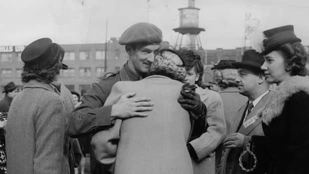 Soldier Emile Turcot hugs his mother, while surrounded by his sisters, on the day he returned to Canada after the Second World War, on Oct. 28, 1945.