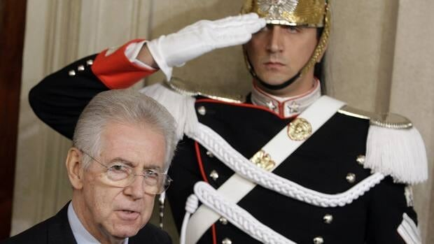 Italian Prime Minister Mario Monti, seen here arriving to talk to reporters at the end of a meeting with Italian President Giorgio Napolitano at the Quirinale Palace in Rome, was sworn in Wednesday with his new cabinet.