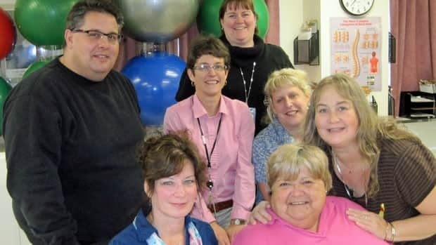 Patients Susan Jonasson and Lesley Read (seated at the front) say the chronic pain management program at St. Joseph's Hospital has changed their lives.  They credit the team around them:  exercise specialist Brad Beyak, physiotherapist Karen St. Jacques, rehabilitation assistant Tabatha Kennepohl, psychometrist Kerri Andrychuk and therapeutic recreation specialist Raili Ranta.
