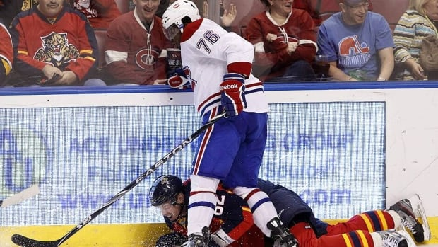 PK Subban of Montreal checks Florida forward Tomas Kopecky into the boards early in Saturday's game.
