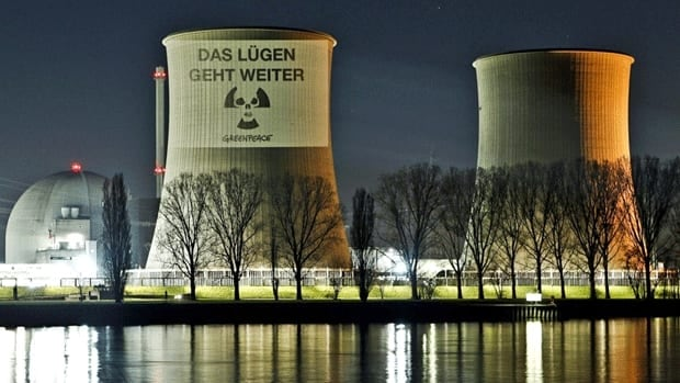 Activists of the environmental organization Greenpeace have projected a slogan reading 'The lying continues' on one of the cooling towers of a nuclear power plant in central Germany on March 21, 2011.