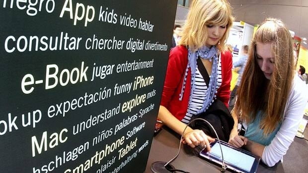 Young women test out an e-reading device at the 2011 Frankfurt Book Fair on Oct. 12.