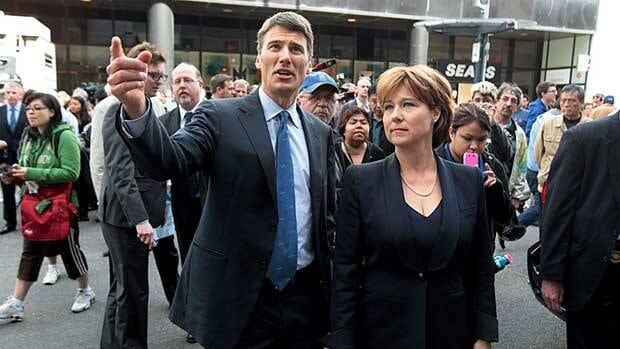 Vancouver Mayor Gregor Robertson, left, and British Columbia Premier Christy Clark tour Granville St. in Vancouver, B.C., on Thursday, after business were damaged and looted by rioters following the Vancouver Canucks loss to the Boston Bruins in the NHL's Stanley Cup Final Wednesday night.